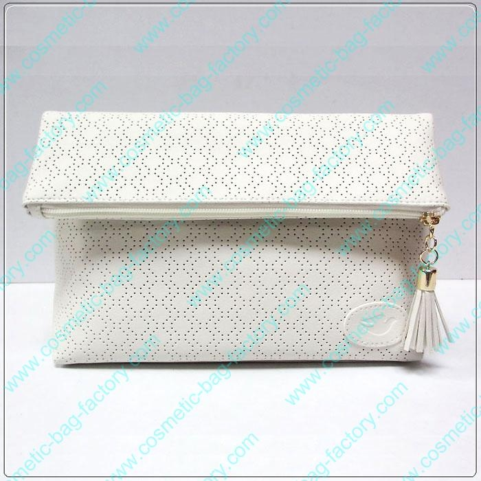 Howllow pattern folding makeup cosmetic bag with tassel